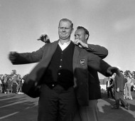 Jack Nicklaus' first Masters title came in 1963. Arnold Palmer, who won in 1962, helps him on with the green jacket.