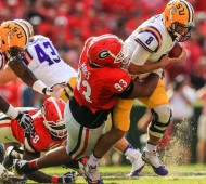 LSU QB Zach Mettenberger gets taken down by a GA defender (Daniel Shirey / USA TODAY Sports)