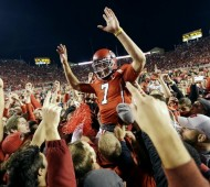 Utah fans lift QB Travis Wilson after the Utes upset Stanford (AP Photo/Rick Bowmer)