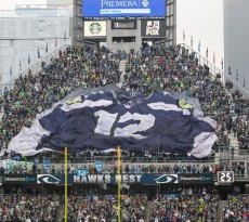 """Seattle Seahawks fans hold a giant """"tifo"""" banner of a 12th-man jersey at CenturyLink Field before an NFL football game against the St. Louis Rams, Sunday, Dec. 29, 2013, in Seattle. (AP Photo/John Froschauer) ORG XMIT: OTK"""