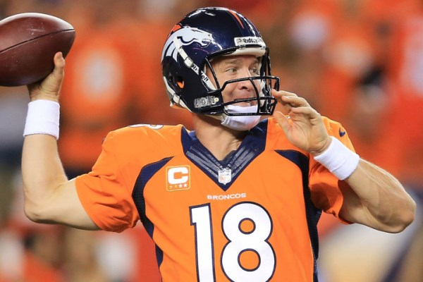 DENVER, CO - SEPTEMBER 5: Peyton Manning #18 of the Denver Broncos throws a pass against the Baltimore Ravens in the third quarter during the game at Sports Authority Field at Mile High on September 5, 2013 in Denver Colorado. (Photo by Doug Pensinger/Getty Images)