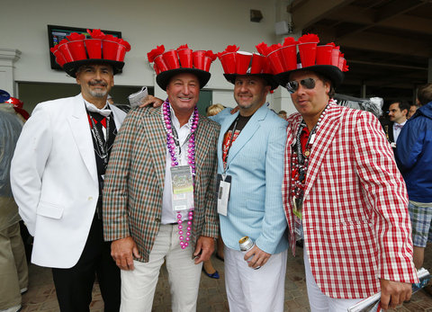 Attendees wear matching elaborate hats before the running of the 139th Kentucky Derby horse race at Churchill Downs in Louisville