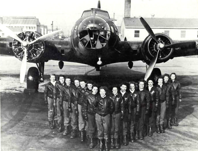 WASPs standing in front of a B-17
