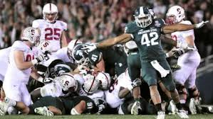 Michigan State defenders celebrate a 4th down stop that sealed the Rose Bowl victory