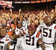 Virginia Tech players celebrate their upset over Ohio State