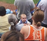 Baby KC Royals Fan Gives Tigers' Fan Stank Face, Flips Her Off