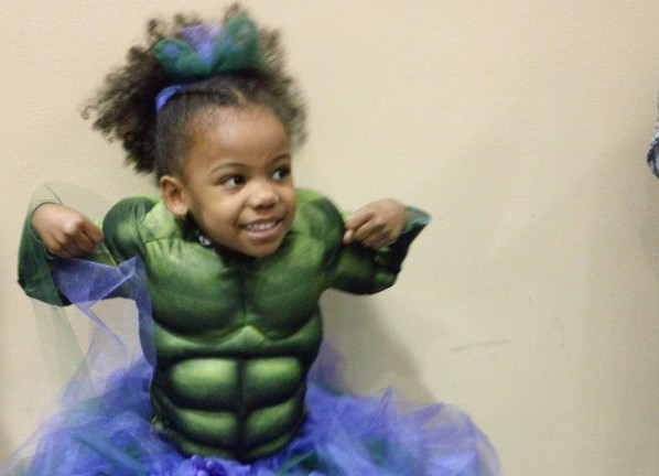 Little Girl Dressed As Hulk In A Purple Tutu