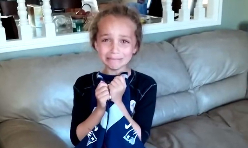 Watch as this little girl is surprised with tickets to a Patriots game
